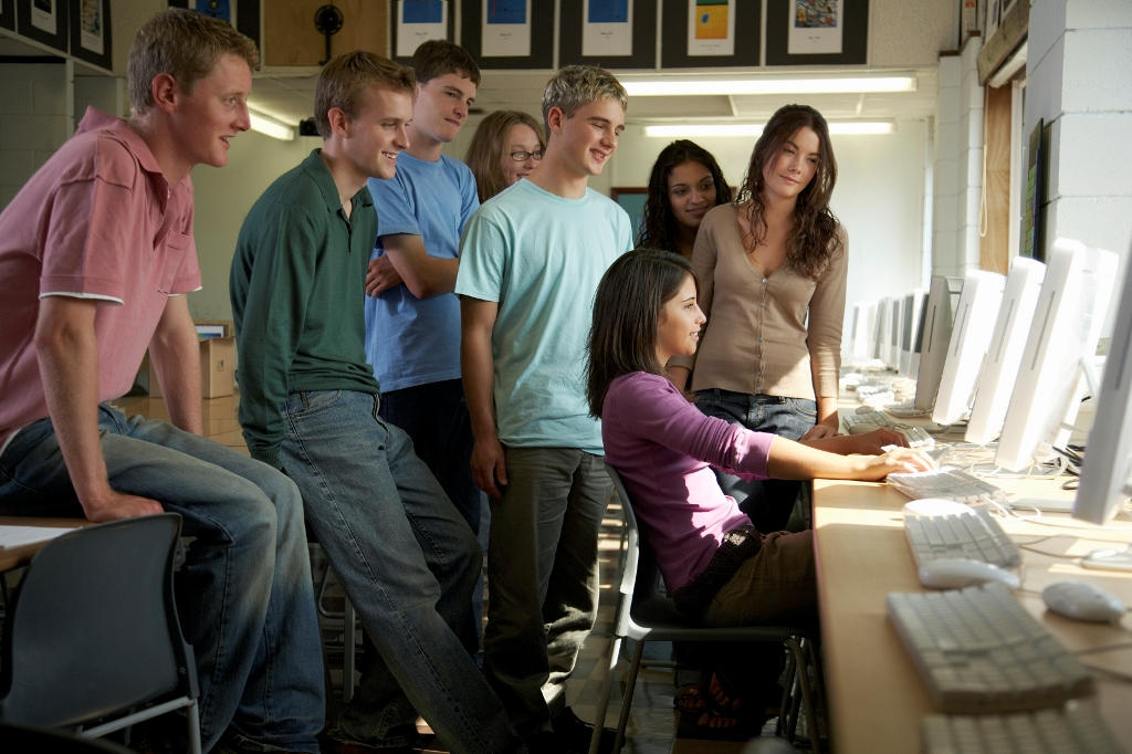 Students surround computer